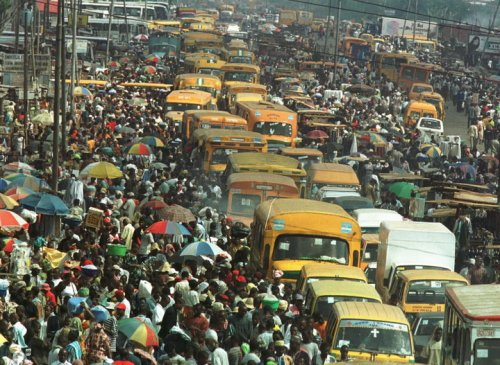 COMMUTERS AND TRADERS CROWD NIGERIAN COMMERCIAL CAPITAL.